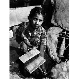 Navajo Girl Carding Wool