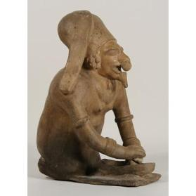 Figure with a Metate