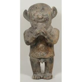 Jaguar Figure Holding a Ball
